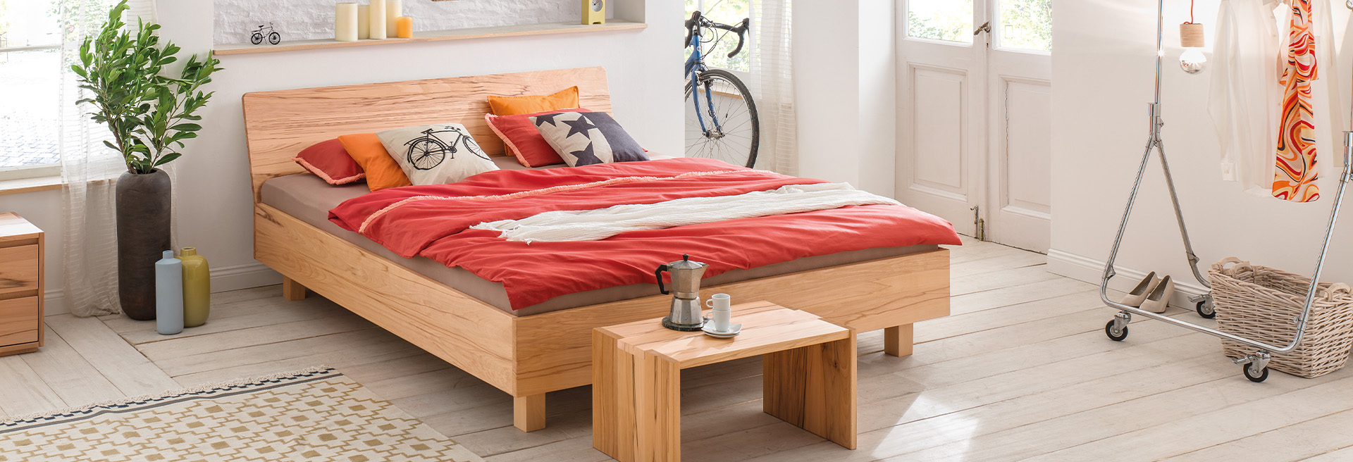 Solid wood bed in a youth room